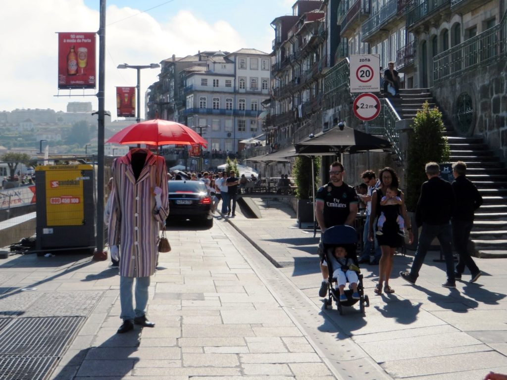 Man with umbrella in Porto