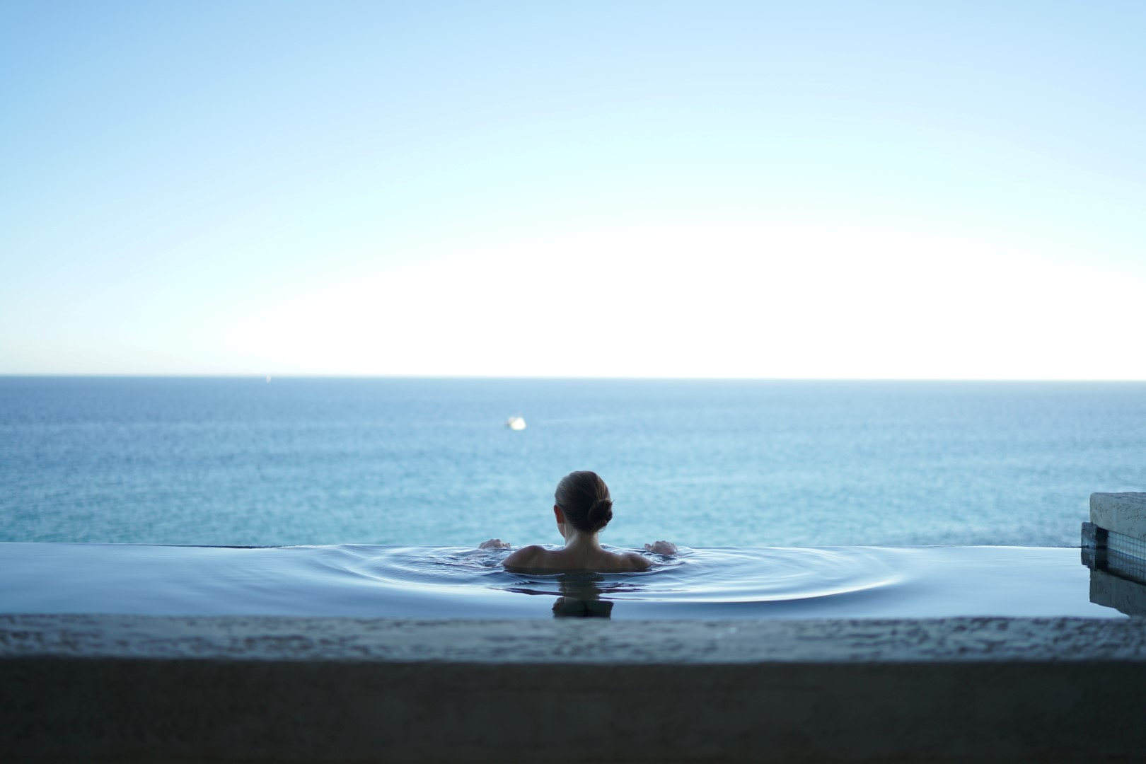 lady in an infinity pool