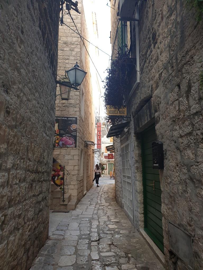 Chaming historic cobbeld streets in Trogir, Croatia